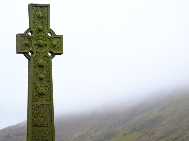 Cross, clouds, hills