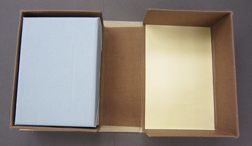 Clamshell box holding six smaller enclosures