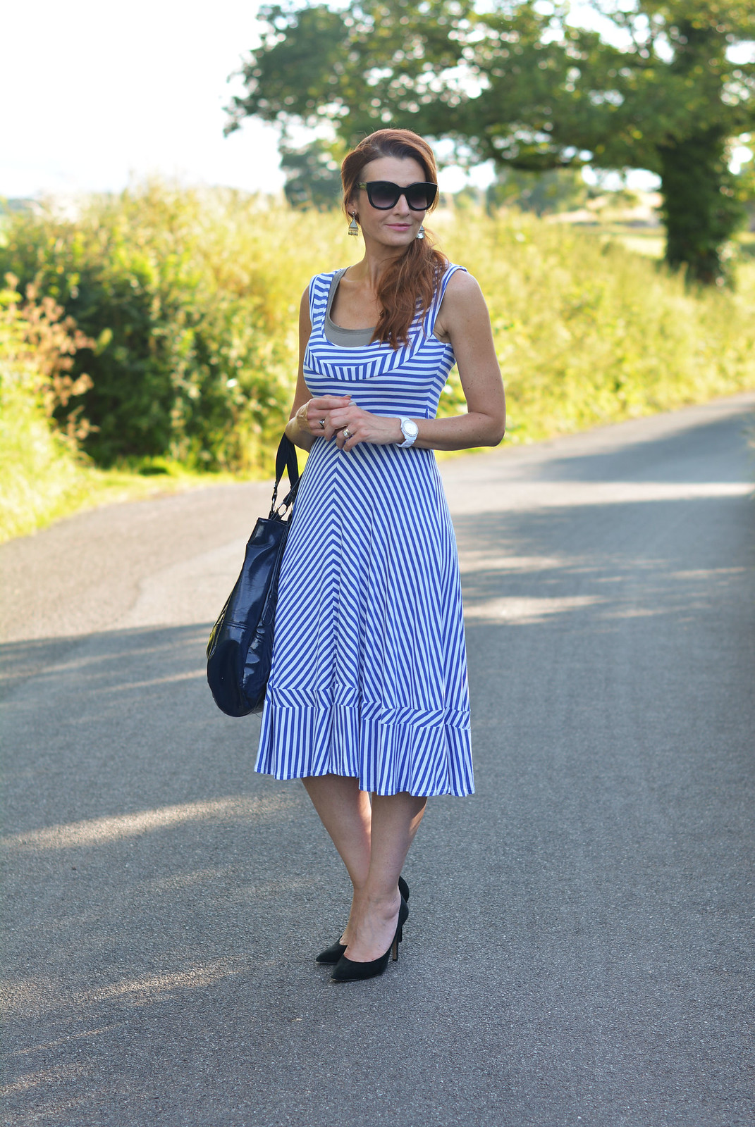Blue and white striped midi dress, black heels, black belt