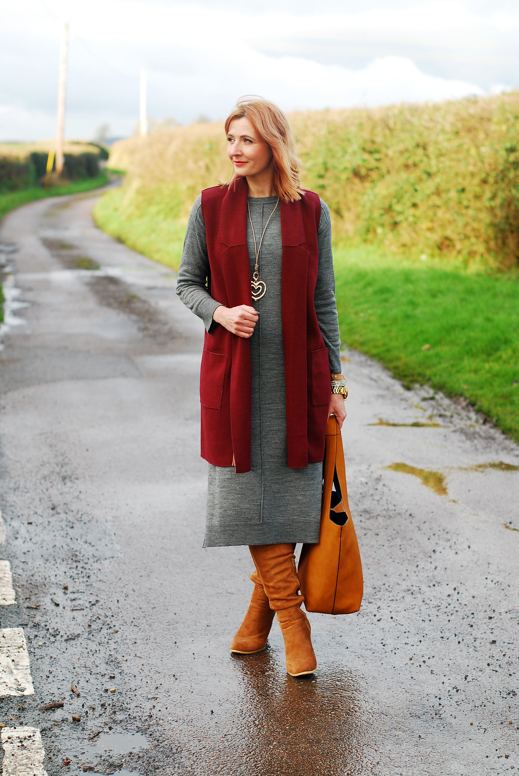 Winter layers: Burgundy sleeveless coatigan \ grey midi sweater dress \ tan over the knee (OTK) boots \ ochre slouch hobo bag \ rose gold heart pendant | Not Dressed As Lamb, over 40 style blog