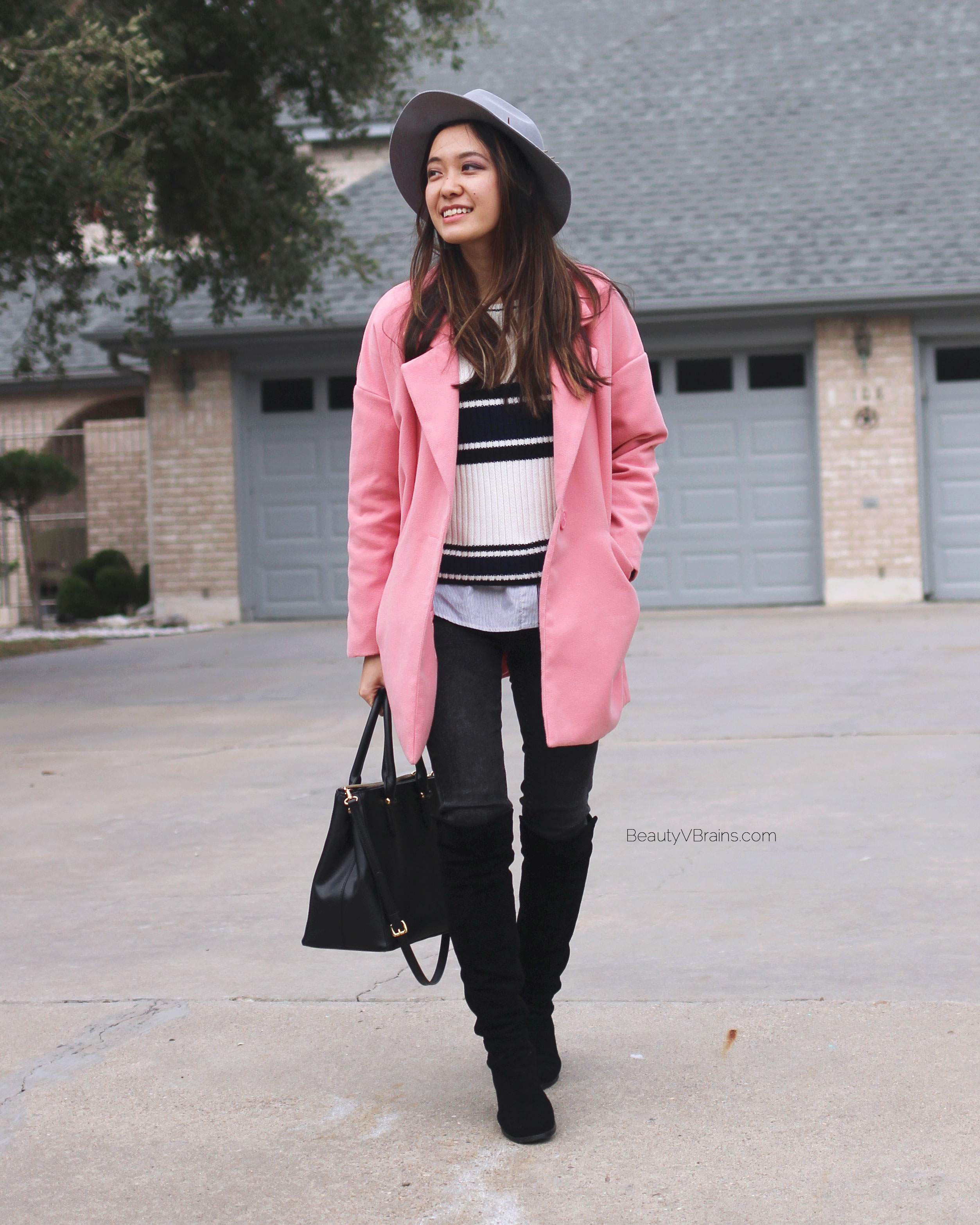 Pink cocoon oversized coat and black over the knee boots