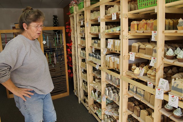 Laura Kneib standing in front of soap racks in her store