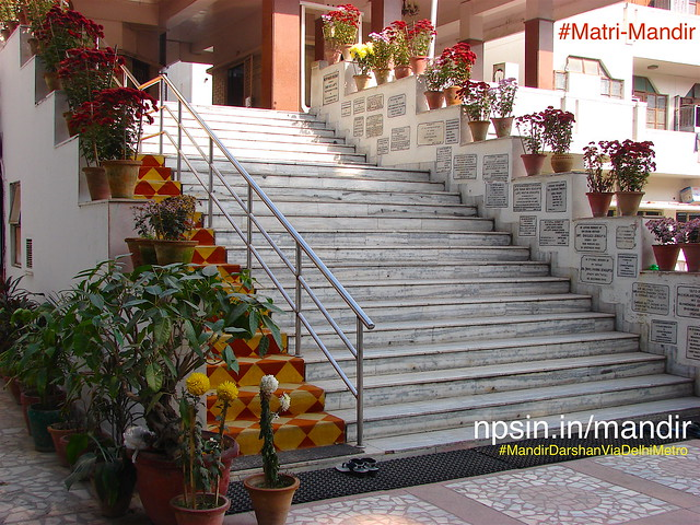 Entry stairs towards main prayer hall, decorated with two the rows of different flower plants.
