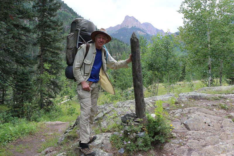 Me and the signpost for the junction of the Johnson Creek Trail and the Vallecito Creek Trail