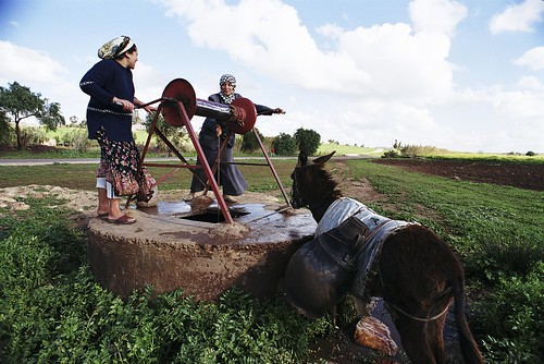 Retrieving water from a well | by World Bank Photo Collection