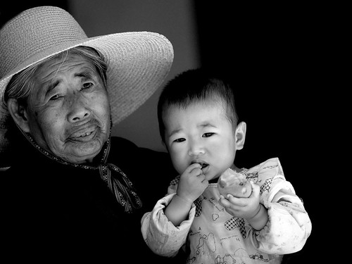 Baby and grandmother, Yunnan, China | by Eric Lafforgue