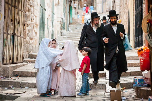 Orthodox Jewish men and Muslim children