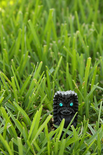 Tiki in Grass | by Sam Howzit