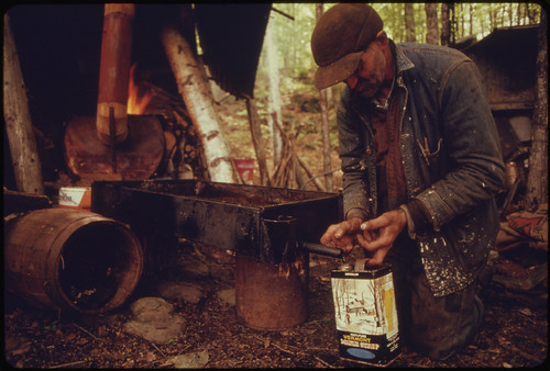 Resident of Roxbury, Vermont, Draws Off the Finished Syrup From a Homemade Evaporator ..., 05/1974 | by The U.S. National Archives