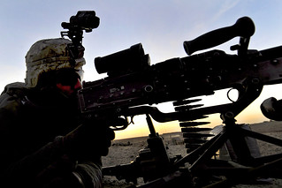 Manning an M-240B machine gun | by The U.S. Army