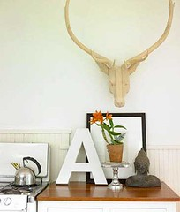White kitchen: Artful display + faux deer head + Benjamin Moore 'Snow White' | by SarahKaron