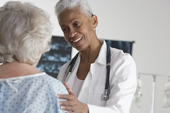 Doctor Speaking with Elderly Patient | by homecaregiverstore@gmail.com