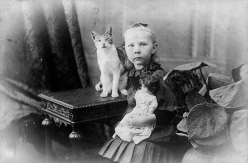 Hulda Lundager with her cat and her doll in Mt. Morgan | by State Library of Queensland, Australia