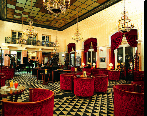 Art deco Interior Design with red seats and cool ceiling and floor at Lutetia Bar at the Hotel Lutetia Paris, Rive Gauche, France | by Concorde Hotels Resorts