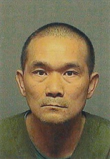 Wayne Lu, 53, booking photo | by CA Dept of Insurance