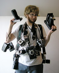 (Scruffy) Guy With Cameras by Hambone Lewinski