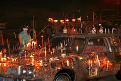 Dia de los Muertos, Day of the Dead, All Souls Procession, Tucson Arizona, 2007 --- Gal lighting candle on Art Car