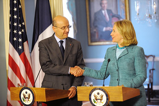 Secretary Clinton Shakes Hands With French Foreign Minister Juppe