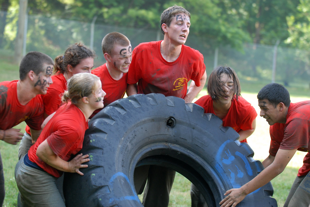 High school students participate in a tire-rolling race during the 2011 U.S. Naval Academy Summer Seminar Sea Trials