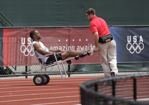 Tyson Gay is helped off the track after an injury in the 200 meter quarterfinal on day 7 of the Olympic Trials at Hayward Field, July 5, 2008, in Eugene, Ore.