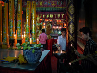 Lighting joss sticks as an offer to the gods | by B℮n