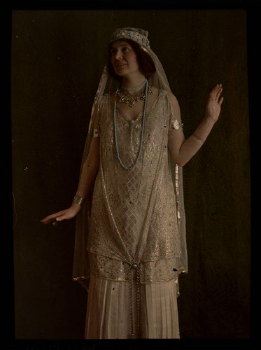 Woman in gold costume | by George Eastman House