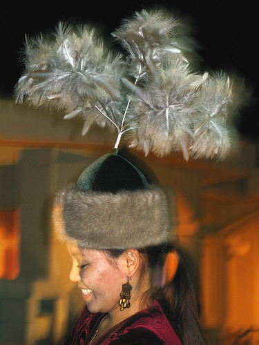 Osh: traditional hat with feathers on a Kyrgyz folk singer | by Captain Claudia