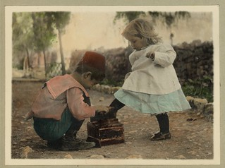 Vintage Picture of Two Children, A Cute Boy giving a Shoe Shine to a Beautiful Little Blonde Girl | by Beverly & Pack