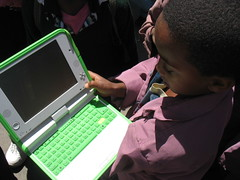 child going to school with his XO laptop | by Terri O'Sullivan