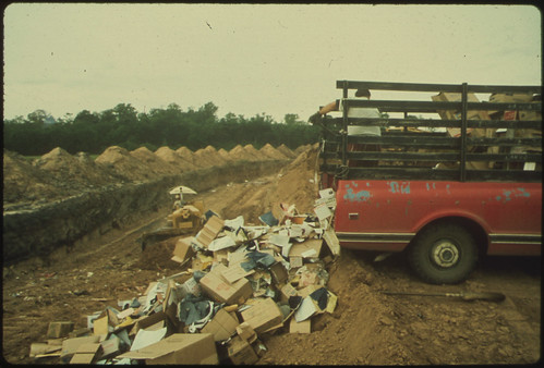 Solid Waste Is Dumped Into Trenches at a Sanitary Landfill ..., 06/1972 | by The U.S. National Archives