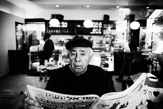 "a man reading the ""Israel Today"" newspaper 