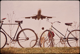 Jet Roars over Bicycle Path near Washington's Nation Airport. Noise-Decibel Level from Aircraft at This Altitude Can Cause Permanent Ear Damage. 11/1972 | by The U.S. National Archives