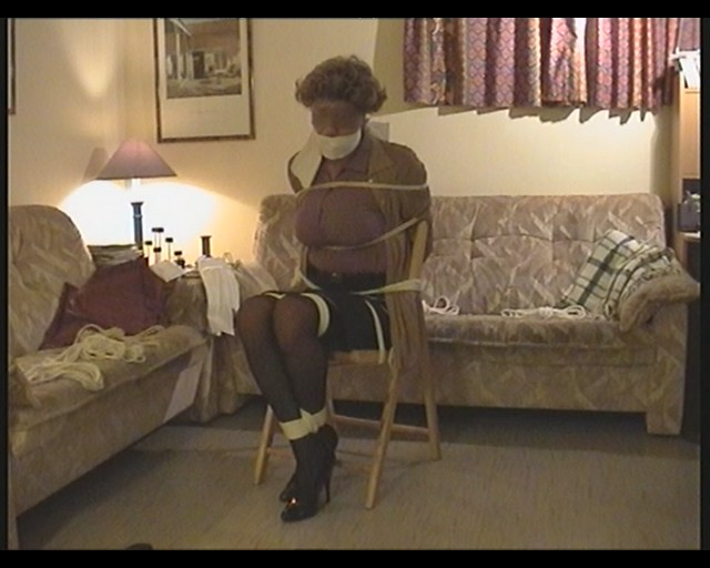 Brunette chick Isabella Chrystin is left tied to a chair with her tits exposed  1668549