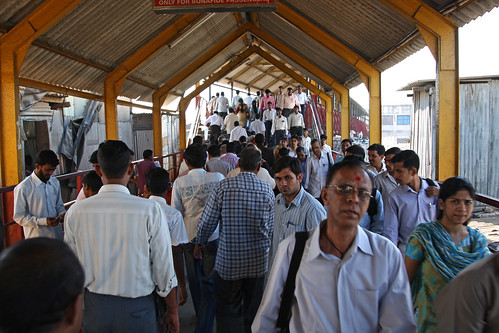 Passengers and commuters in a train station in Mumbai | by World Bank Photo Collection