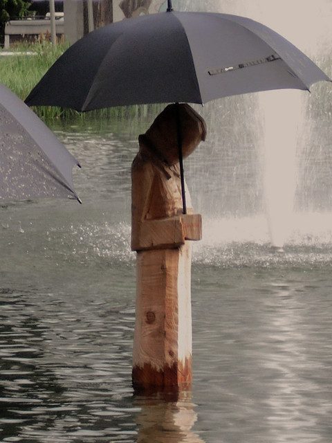 Even statues need umbrellas