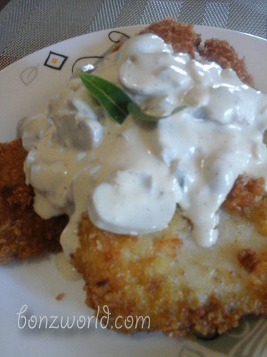 fish fillet in white sauce