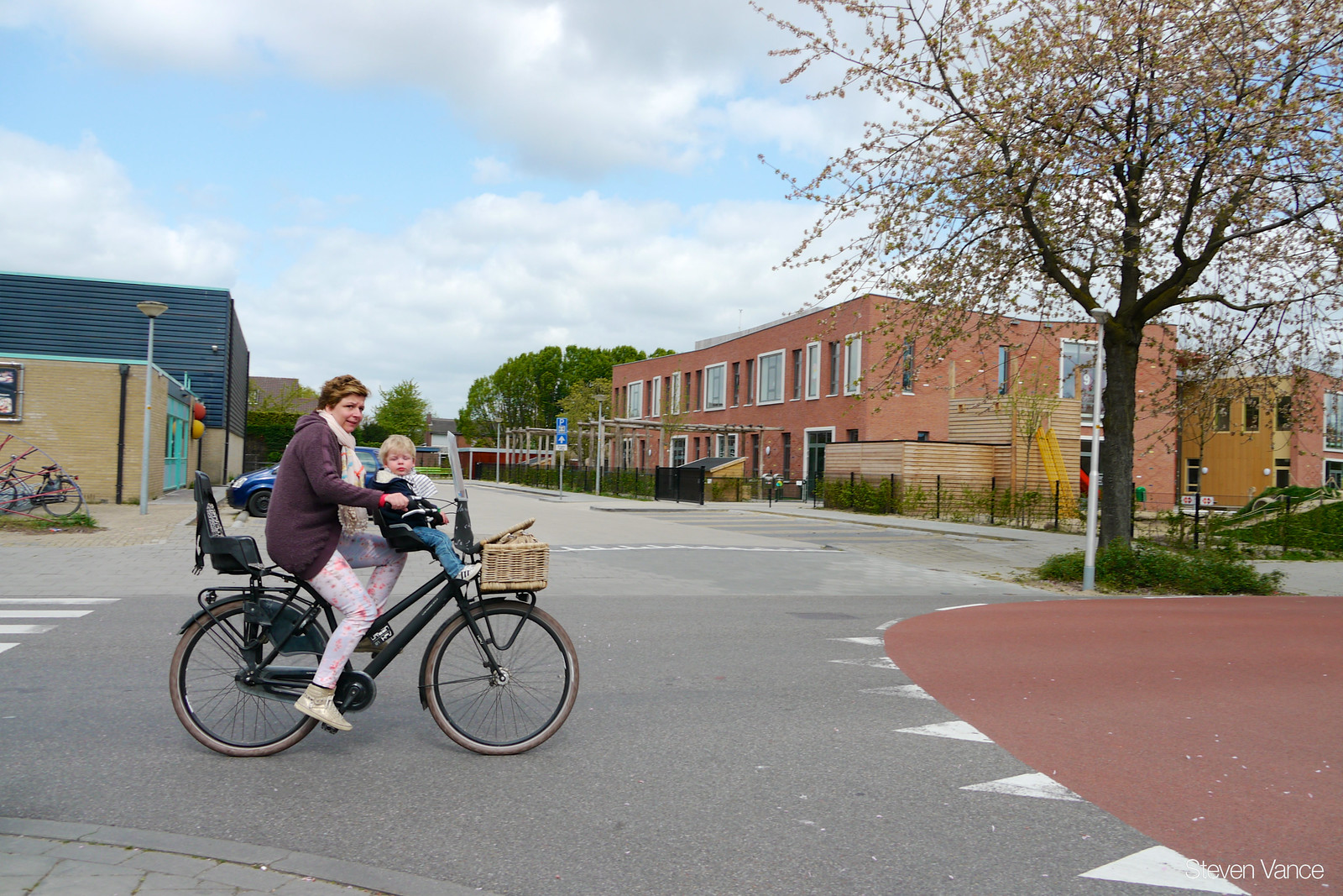 A biking family about to enter the cycle priority street