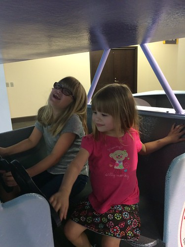 Flying an airplane at the kids' museum.