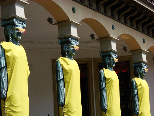 Winkel van Sinkel Caryatids ready for Tour de France wearing yellow dresses and sunglasses