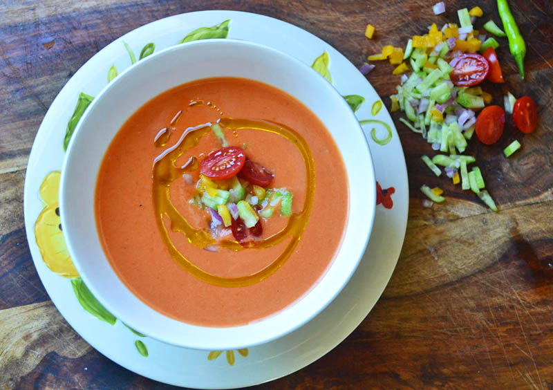 Silky Smooth Tomato Gazpacho via filled with bright summer produce, a secret ingredient and a bit of a kick from tart vinegar via LittleFerraroKitchen.com