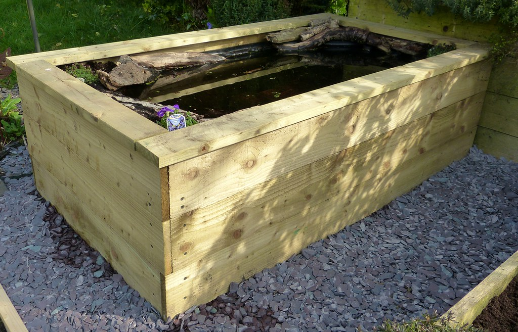 Railway sleeper ponds lee neighbour 39 s koi pond with for Raised garden pond ideas uk