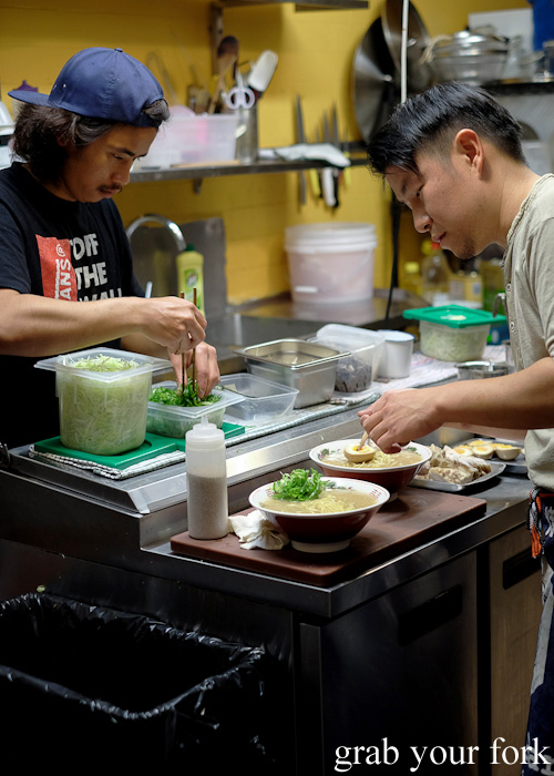 Chef Keita Abe adding the toppings onto ramen bowls at Chaco Bar, Darlinghurst