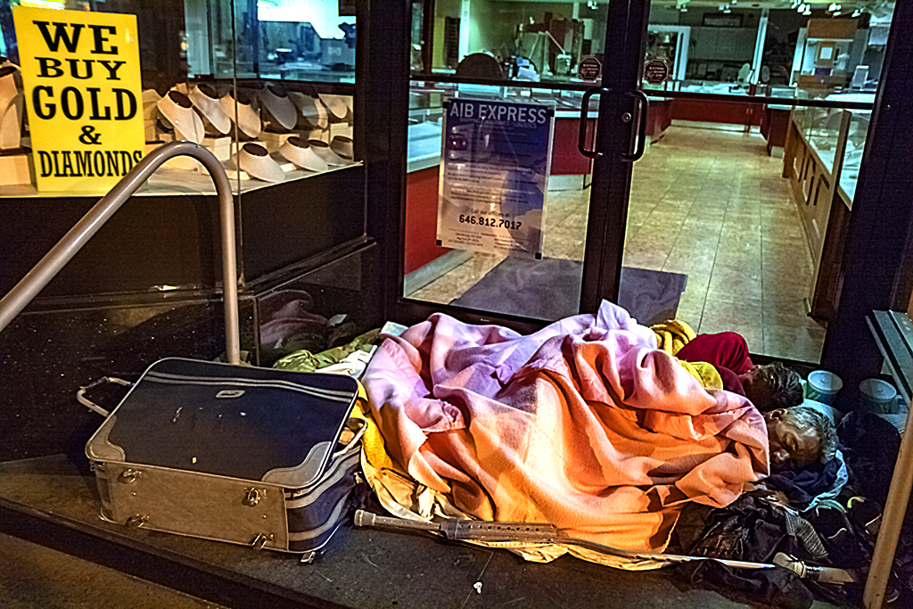 Old-couple-sleeping-at-jewelry-store-entrance-on-9-16-14--Center-City