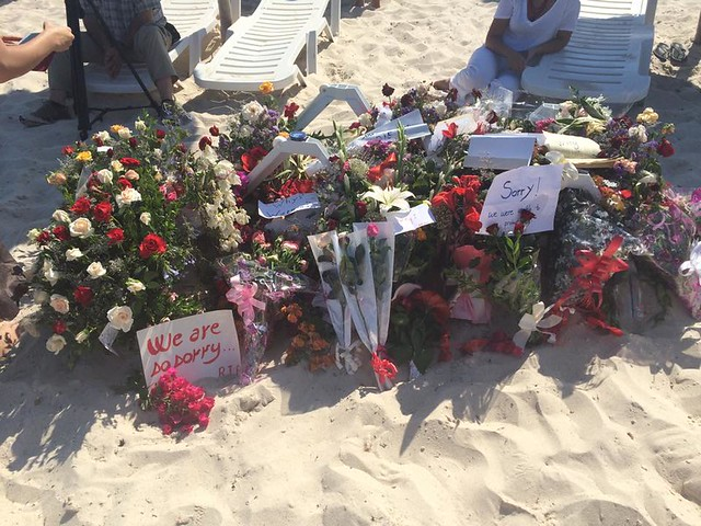 Floral tributes along the beach in Sousse. Credit: Sybil Bullock