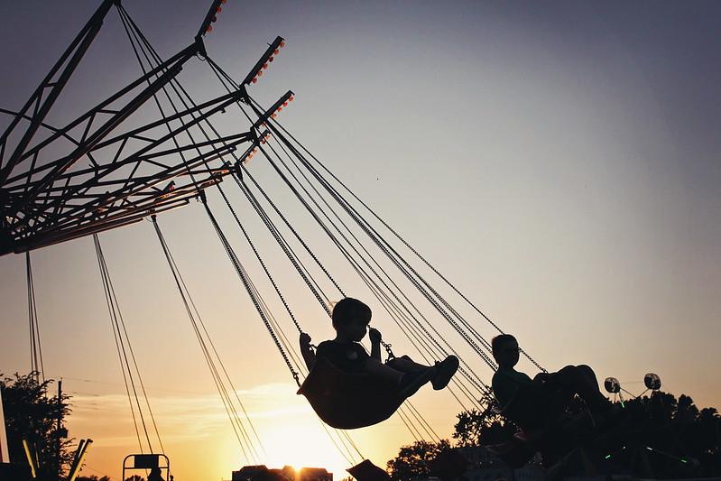 Tate on a Carnival Swing | Kansas Photographer