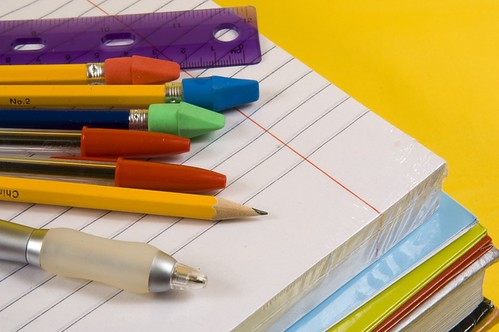 School Supplies on yellow background | by rebeca_falcó