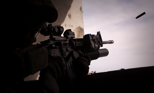 Marine fires a round down range | by United States Marine Corps Official Page