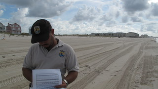 Carlos Pacheco going over beach bird study data sheets | by USFWS/Southeast