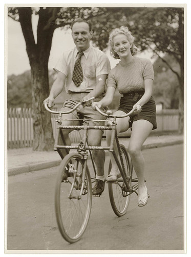Man and woman on a Malvern Star abreast tandem bicycle, c. 1930s, by Sam Hood | by State Library of New South Wales collection