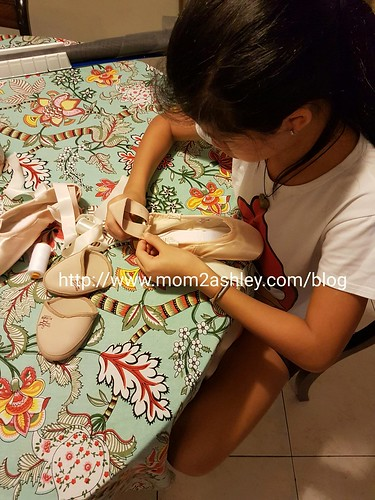 Mending her ballet shoes. SheShe's all grown up now.
